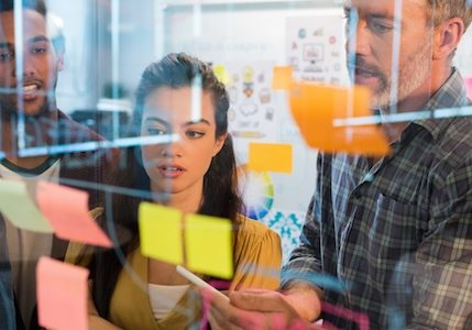 Team using design principles to make better organization alignment decisions